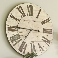 Lanier Wall Clock - Crafted of wood and hand finished in antiqued ivory with distressed edges and dark chestnut undertones