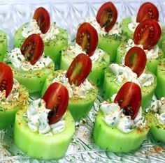 Cucumber Bites  4 Oz Cream Cheese, Soft to room temp 1/4 C Ranch Dressing  2 TBS Dill  3-4 Cucumbers. 1 in. slices 15 Cherry Tomatoes, sliced  Paprika/Cajun Spice Mix  HERB CREAM CHEESE Mix Cream Cheese, Ranch dressing and herbs. Peel of the Cucumber, score the sides. Slice into 1 in pieces. Using a melonballer, leaving a half moon crater. Pipe the Herb Cream Cheese into the crater. Enough to stick out of the top. Bury half Cherry tomato into the Herb Cream Cheese Serve Chilled