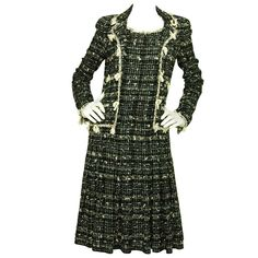 Chanel Black & White Tweed Dress w. Attached Jacket and Fringe Trim - sz.40 | From a collection of rare vintage day dresses at http://www.1stdibs.com/fashion/clothing/day-dresses/