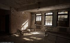 PIC FROM CATERS NEWS - (Pictured a day room inside an empty asylum)  Read more: http://www.dailymail.co.uk/news/article-2274303/Haunting-images-rusting-gurneys-operating-tables-patients-subjected-terrifying-Nazi-style-experiments.html#ixzz2pYE2wE1m