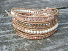 Beaded Leather 4 Wrap Bracelet with Peach Pink Champagne Czech Glass Beads on Natural Tan Leather. $46.00, via Etsy.