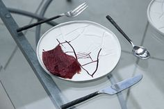 bloody meal, liquid on the plate runs into cracks that form shapes in the plate