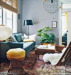 Turquoise sofa love, and an eclectic and warm living room (Julianne Moore living room redo, from Domino)
