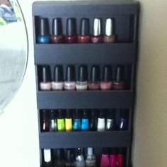 Mini nail polish rack made out of black foam board. I have 2 of these - one on either side of my vanity mirror.