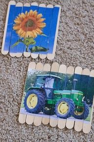 TODDLER TIME ACTIVITY: POPSICLE STICK PUZZLES = it is easiest to tape the popsicle sticks to the table with masking tape to keep them together, then glue pictures on with Elmers glue, and let dry. Cut between the sticks with an x-acto knife. Pictures of family members and pets with their names added underneath with a Sharpie are especially fun to put back together!!