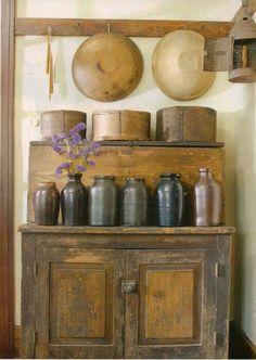 with old wooden bowls, measures, & old crocks. Primitive Homes, Primitive Kitchen, Primitive Antiques, Primitive Crafts, Country Primitive, Kitchen Country, Primitive Fireplace, Primitive Snowmen, Jars