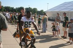 Greg Jennings on a bike at training camp....ONLY with the Packers will you see this...