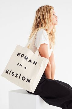 FEED Woman On A Mission Tote Bag | Urban Outfitters
