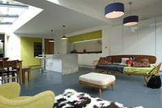 : Brilliant Modern Kitchen Design With Glossy Grey Floor Cow Skin Fur Carpet And Blue Navy Cover Of Drum Pendant Lighting