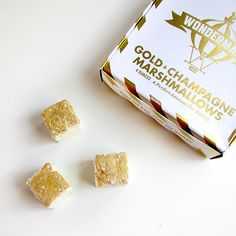 {sugarfina.com} Gold dipped champagne flavored marshmallows ~ $24