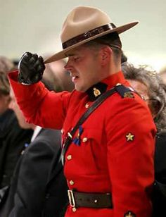 Royal Canadian Mounted Policeman can barely hold his salute to fallen brothers after mass shooting.