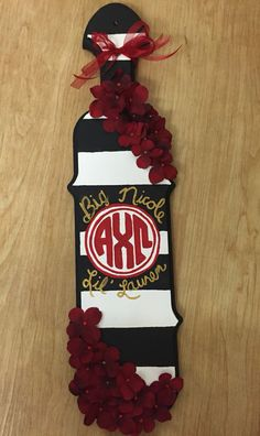 sorority paddles for big/little- could do white and yellow stripes with a purple monogram and raised letters for name Phi Sigma Pi, Alpha Phi Omega, Delta Phi Epsilon, Alpha Chi, Kappa Delta, Chi Omega, Phi Mu, Tri Delta, Sorority Canvas