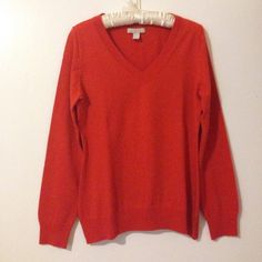 Merino Wool Orange Sweater Great condition, like new. Hand wash cold, long sleeves, v-neck, size large, Banana Republic sweater. A true classic for your closet! Banana Republic Sweaters V-Necks