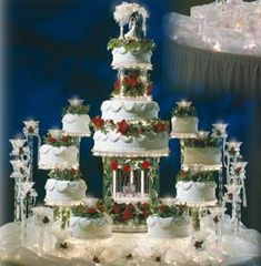 12 Tier unique wedding cake structure with beautiful flowers and other decorations. Amazing Wedding Cakes, Unique Wedding Cakes, Wedding Ideas, Wedding Stuff, Amazing Cakes, Elegant Wedding, Fountain Wedding Cakes, Christmas Wedding Cakes, Cake Structure