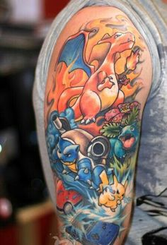 Tattoo pokemon charizard, blastoise and ivysaur... or is it venisaur? Wwho cares...