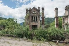 """View of my ghost town in the Tkvarcheli valley, Abkhazia. From the series """"Heteroclite Voyage—Abkhazia. Architectural Photographers, French Photographers, Abandoned Buildings, Abandoned Places, Gate City, Monumental Architecture, World Industries, State Of Decay, My Ghost"""