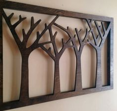 Forest wall art cut from birch wood    Stained dark walnut    There is no background so your wall color shows through the cutouts    Ready to hang