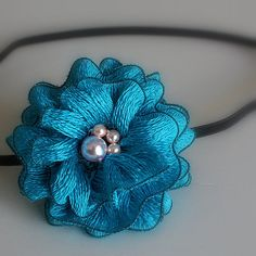 Beautiful colour, and great use of crochet + pearl beads!