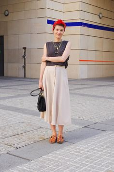 Skirt (A-line) with T-shirt or sleeveless top, sandals or sneakers.