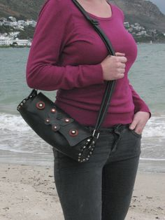 The Butterfly design rubber handbag is made from recycled inner tube which makes it vegan, washable and durable. What not to love about this bag?!  Buying this bag will create a Butterfly effect! ☺ And will definitely make waves in your world! #affiliate #handbag #black #unique #studded #accessories #onlineshopping #creatorsmarket #fashion #purseaddict #purselover #accessory #bag #purse #shopping #fashiondesign #handbags #vegan