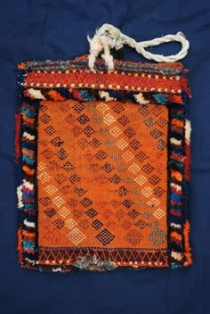 """Reverse - Antique Spindle-Bag, Qashqa'i Tribes, South-West Persia  This beautiful old Spindle-Bag is in excellent condition bar a small bite out of the bottom of the bag, as can be seen in the close-up image. Dating to around 1900, the colours are all natural - the orange colour derived from mordanted madder. Although mainly flatwoven, the bag consists of a knotted-pile border and charming tufts of woollen pile in the compartmentalised field.  Size: 41cm x 33cm (1' 4"""" x 1' 1"""")."""