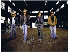 Bon Jovi Group Autograph 8x10 Photo - Jon Bon Jovi, Richie Sambora, David Bryan and Tico Torres - Certificate of Authenticity Included - Please Read Our Service Pledge and Autograph Guarantee - $349