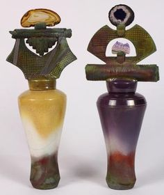 Pair of studio pottery ginger jars, each having an ornately sculptued finial with applied crystals the tapering form accented with yellow and purple glaze, 14 h