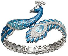 Peacock Bracelet - Lord & Taylor - I adore the beautiful tail but the face is a little creepy!