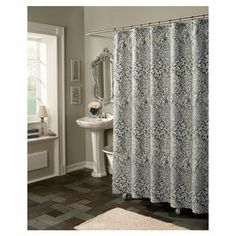 """Blue shower curtain with a floral ogee motif.  Product: Shower curtainConstruction Material: MicrofiberColor: Blue Dimensions: 72"""" H x 70"""" W Note: Shower rings not included  Cleaning and Care: Wash cold and hang to dry"""