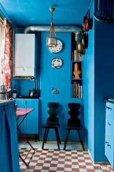 Jovial blue kitchen, with original tiled floor, folding metal table, black lacquer chairs and toile de jouy curtains.The Paris home of designer Virginie Manivet--Story on page 138 of Vogue Living May/June Photograph by Eric Morin. Kitchen Cabinet Colors, Kitchen Colors, Kitchen Cabinets, Kitchen Walls, Kitchen Nook, Kitchen Designs, Deco Turquoise, Sweet Home, Paris Home