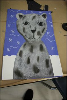 Snow animal art project for preschool, school age kids! Chalk, oil pastels, charcoal, construction paper, snow leopard, polar bear project.