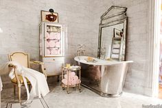 "Designer Betty Lou Phillips chose a luxurious French-inspired theme for the decoration of her Dallas bathroom. She paid attention to details, such as the tub and its floor-mounted water filler, the 19th-century crystal chandelier, the freestanding nickel-leg washstands, the vintage glass pharmacy chest, and fittings that read chaud and froid. ""They give the room character, a period feel. They're functional, too, of course. That's another French trait: their flair for melding the past and…"