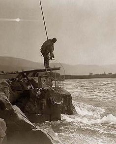 Here for your perusal is a one-of-a-kind photograph of Wishram Fishing Platform. It was created in 1910 by Edward S. Curtis.    The photograph illustrates an Indian man, standing at the end of frame platform, holding fishing net containing fish caught in a natural rock weir below.    We have compiled this collection of photographs mainly to serve as a valuable educational resource. Contact curator@old-picture.com.