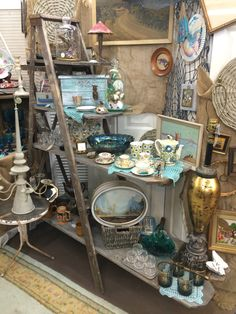 Need this entire shelf and everything with it. Love the ladder for an Antique Mall display.