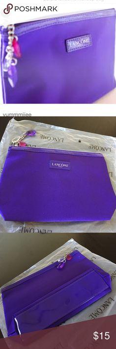 Lancôme make up bag!! New edition purple Lancôme Tavel size make up bag! Lancome Bags Cosmetic Bags & Cases