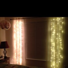 White lights behind sheer curtains. :)