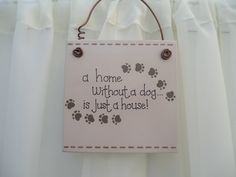 Handmade 'A home without a dog' wooden plaque on Etsy, £7.50