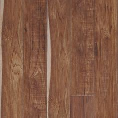 Featuring a subtle, hand-scraped texture, along with knots and sawmarks, Sawmill Hickory has lots of the realistic character found in wood. The natural beauty of an authentic rustic hickory is wonderfully replicated with the handsome floor. Restoration Co Mannington Flooring, Laminate Plank Flooring, Laminate Wall, Hardwood Floors, Flooring Tiles, Stair Nosing, Flooring Store, Rustic Colors, Commercial Flooring