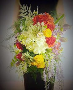 Creativity and drama paint the portrait of this bouquet which features yummy lavender and wisteria~