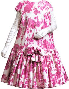 'Baby doll' dress in ivory silk taffeta with floral print in various tones of red and fuchsia | Cristóbal Balenciaga (Spanish, 1895-1972) | Date: 1958 | Cut at the hipline, the bodice is straight with dropshoulder sleeves and a round neckline at the front and back. The full pleated skirt is decorated with a bow made from the same fabric | Museo Cristóbal Balenciaga, Getaria, Spain