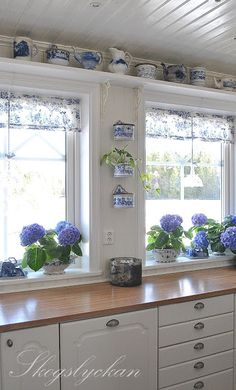 White Swedish kitchen with blue accents. Lovely!