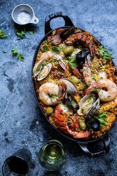 Paella Party 101 - The Entertaining House. Image via Half Baked Harves t Paella is like a party in a pot. This seemingly sophisticated one pot meal traces its humble roots to the coastal town of Valencia,Spain in the Paella, pronou Fish Recipes, Seafood Recipes, Cooking Recipes, Healthy Recipes, Seafood Paella Recipe, Octopus Recipes, Seafood Pasta, Grilled Paella Recipe, Mixed Paella Recipe