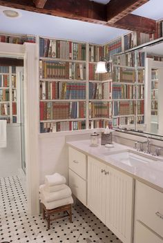 Le Bibliotheque wallpaper in the bathroom by Designer Jennifer Engel, via Kelly Green.