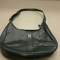 Authentic Etienne Aigner navy blue purse Authentic Etienne Aigner navy blue hand/shoulder bag. Has adjustable strap with gold hardware. Multiple pockets inside with outside zipper pocket on the back of bag. Has an indentation on front. Genuine leather! Etienne Aigner Bags Shoulder Bags