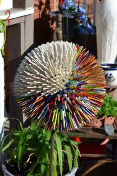 Bowling ball with golf tees to make an Allium flower - patience required ++