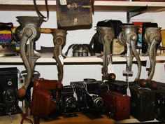 Antique meat grinders and cameras. Meat Grinders, Antique Cameras, Old Wood, Attic, Pottery, Retro, Antiques, Collection, Vintage