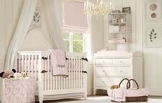 very cute! love the soft pink roman shades!