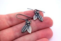 Handcrafted sterling silver botanical earrings from Erin Austin.
