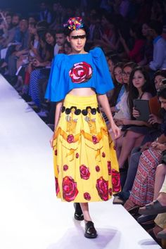 ELLE.IN-KRISTY DE CUNHA FALL/WINTER 2014 - 15 #bold #quirky #avant-garde #style #silhouettes #structured #colors #dresses, #skirts, #shorts #capes #blazers #croptops #vintagestyles #quirk #pop #neoncolors #designs #kristy_decunha
