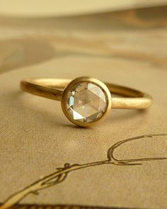 Hey, I found this really awesome Etsy listing at http://www.etsy.com/listing/87910142/5mm-rose-cut-moissanite-ring